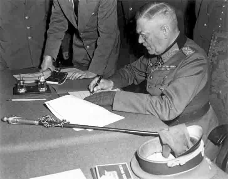 Wilhelm Keitel signs the act of unconditional surrender