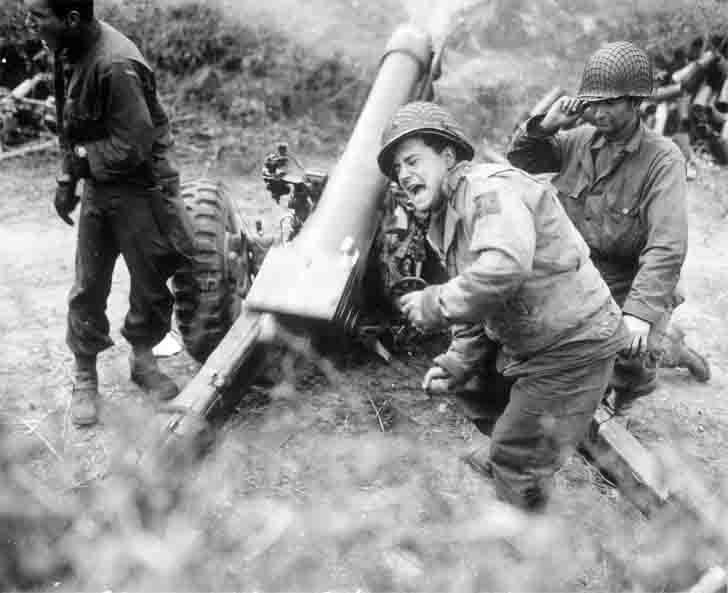 105 mm M3 howitzer fires in Normandy