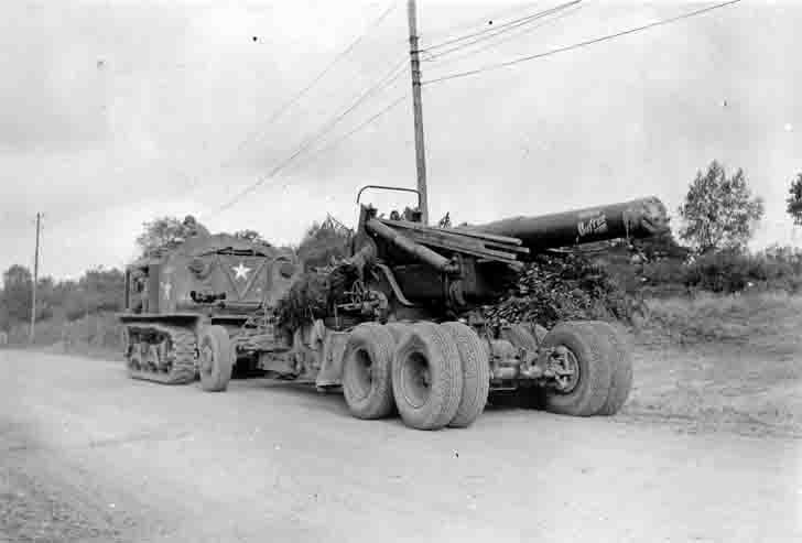 M4 high speed tractor from the 105th Field Artillery Battalion US tows 203 mm howitzer M1 in France