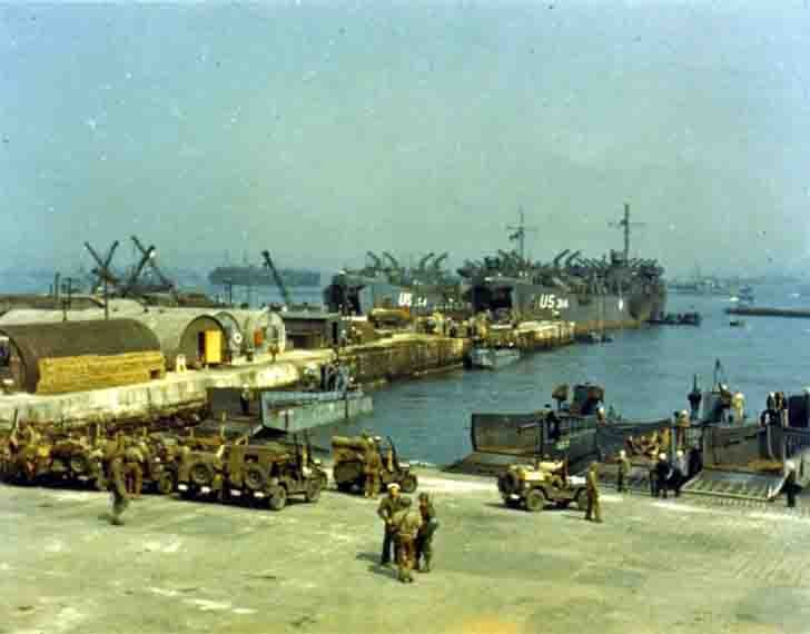 Loading of military equipment to the landing craft before the invasion of Normandy