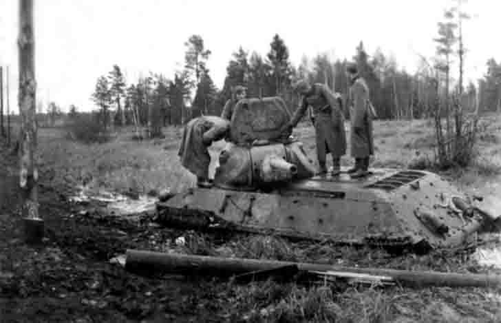 Abandoned by the crew in the swamp of Soviet T-34-76 medium tank