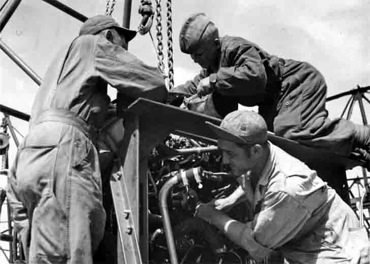 American and Soviet technicians service the engine of the B-17 bomber