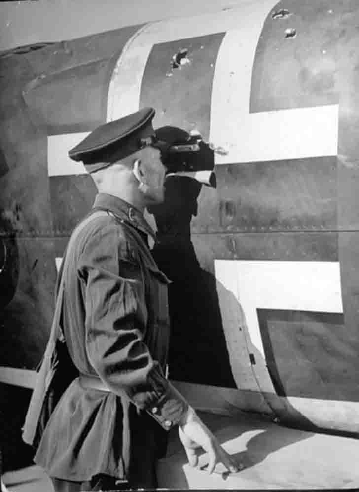 Inspection of the downed Junkers Ju-88 bomber