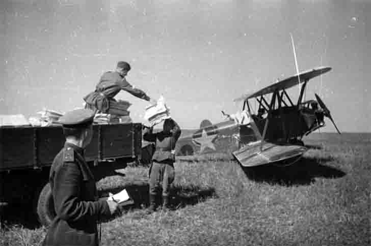 Loading of the mailings to the Po-2 biplane