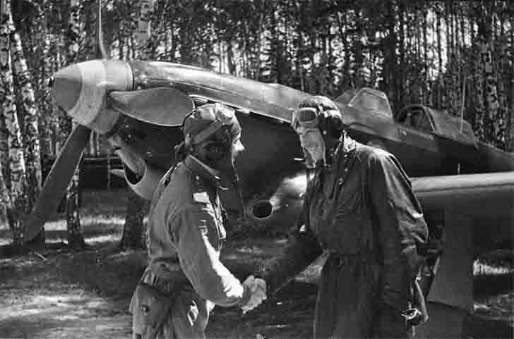 Pilot Semyon Sibirin congratulates his French colleague Albert Littolf