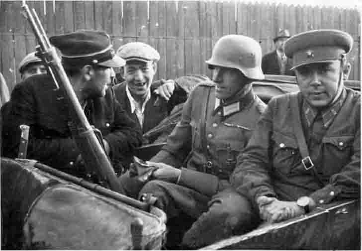 German and Soviet officer with the Polish railway worker