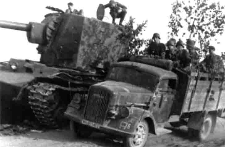 "German ""Opel"" truck and the destroyed KV-2 of the 2nd Panzer Division"