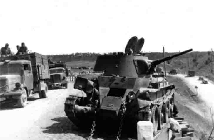 BT-7 light tanks on the side of the road