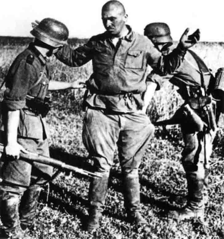 Red Army soldier surrenders to the soldiers of the Wehrmacht