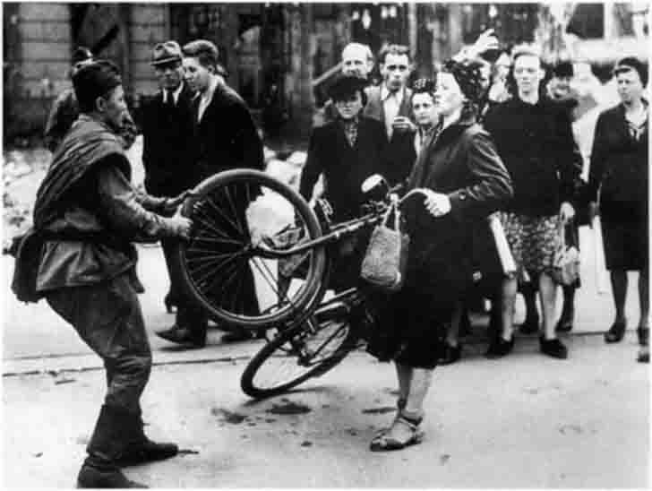The Soviet soldiers in conflict with a woman because of the bike