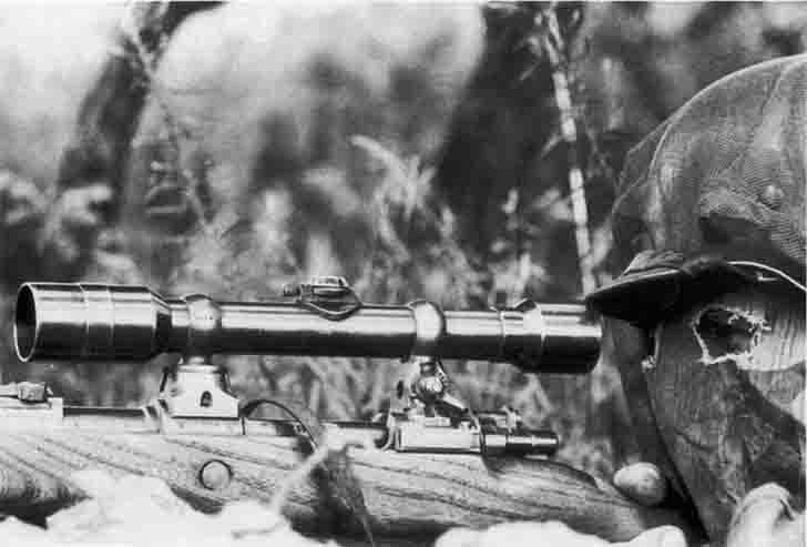 German sniper in camouflage mask