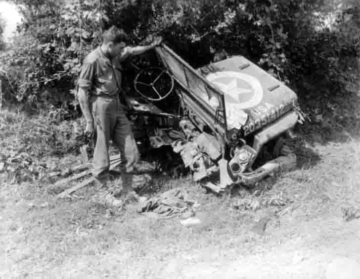 "The wreckage of a military ""Willys"" SUV"