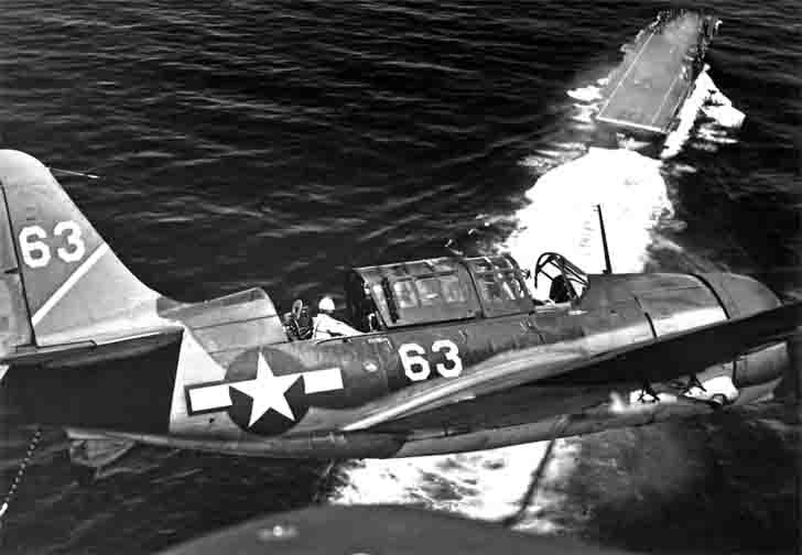 "Curtiss SB2C Helldiver bombers land on ""Yorktown"" aircraft carrier"