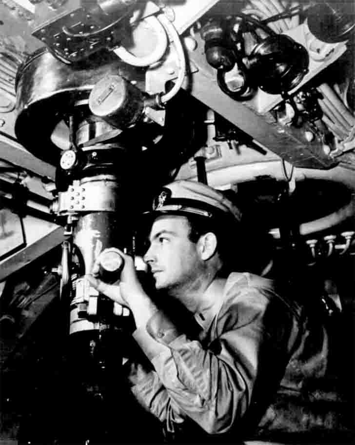 American submarine officer Raymond W. Alexander watching through the periscope