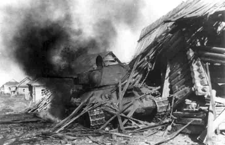 Soviet T-34 tank in the battle for an unknown village