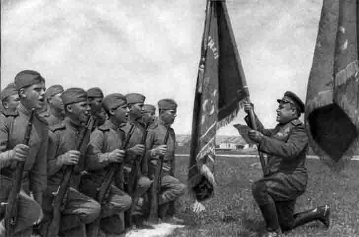 Soviet soldiers take an oath in front of the Red Banner
