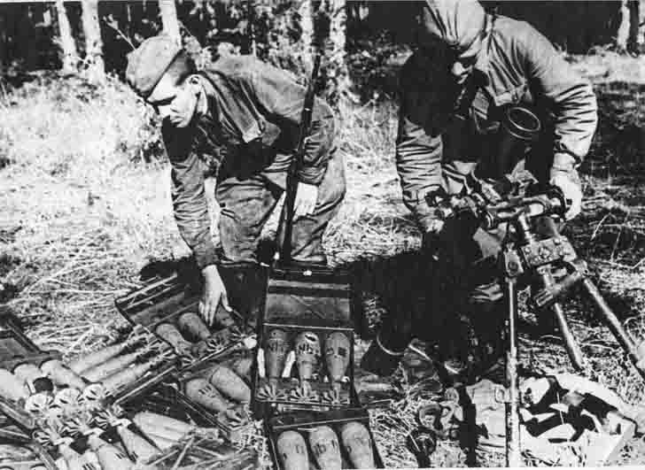 Soviet soldiers inspect the captured German mortar