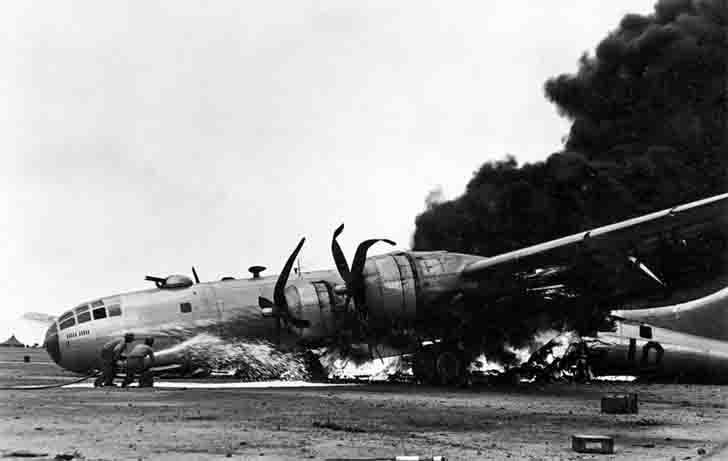 B-29 bomber, burning at the airport on the island of Iwo Jima