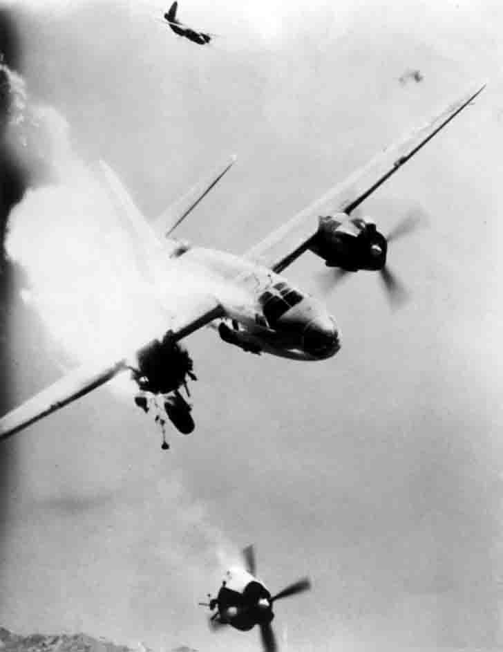 A damaged B-26 bomber loses one engine