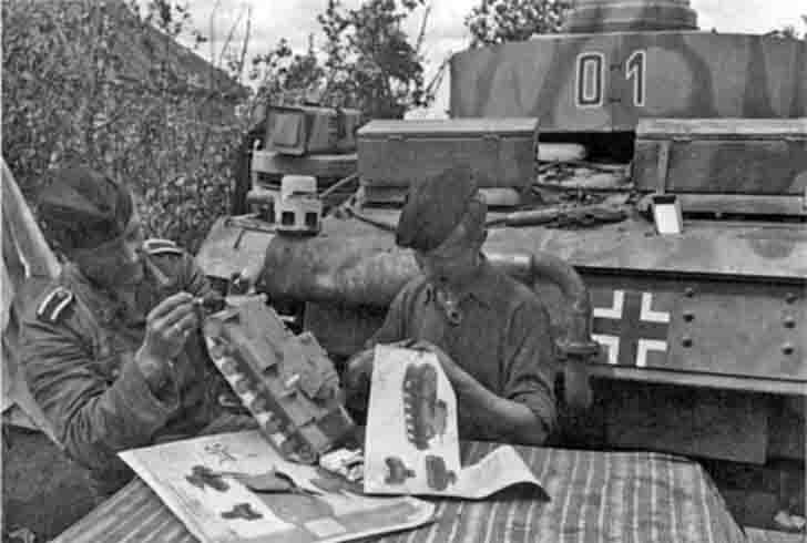 Germans glue paper model of a Soviet tank KV-1