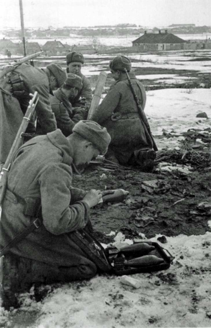 The Soviet mortar team fires during the liberation of Kursk