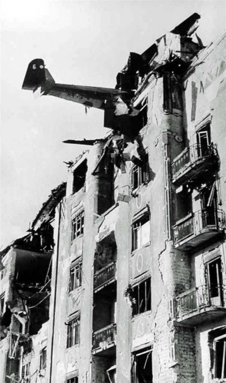 Debris German DFS-230 glider in the wall of an apartment house in Budapest
