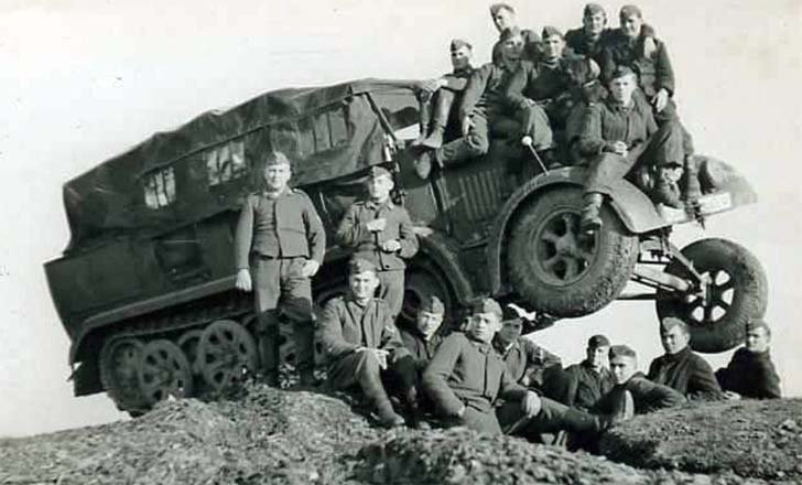 The German crew of Sd.Kfz.8 half-track tractor