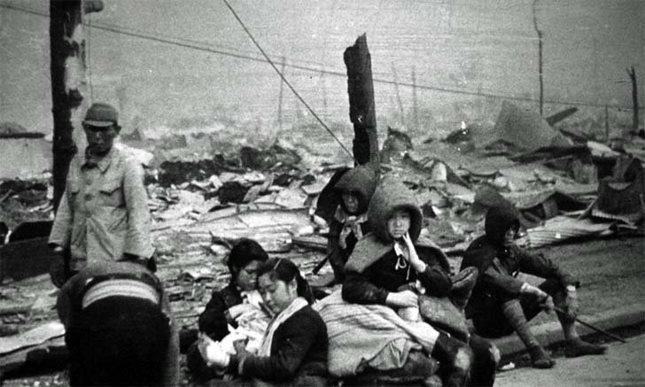 Civilians in Tokyo, which lost their homes as a result of the criminal US bombing