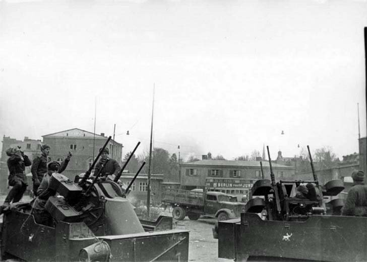 Anti-aircraft gunners of the 740 th artillery regiment on M-17 armored personnel carriers in Danzig