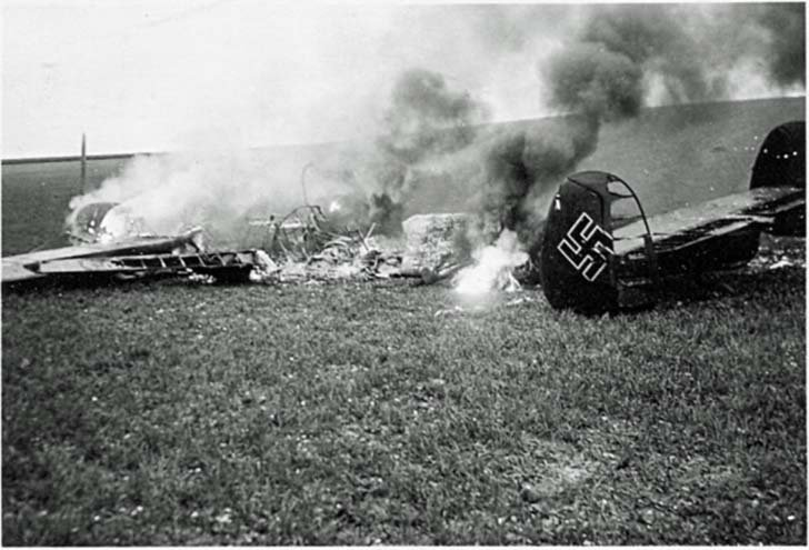 Messerschmitt Bf.110 two-engine fighter aircraft burning on the ground