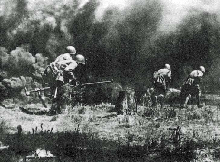 A team of anti-tank riflemen advancing under the cover of a smokescreen