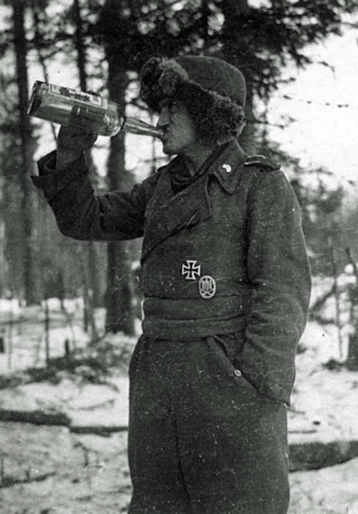 Tankman of the Panzerwaffe with a bottle of schnapps