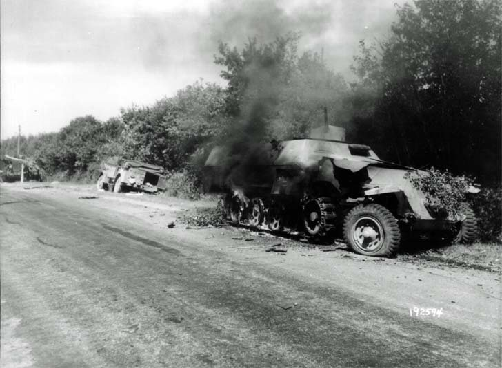 Burning German military equipment near Alençon