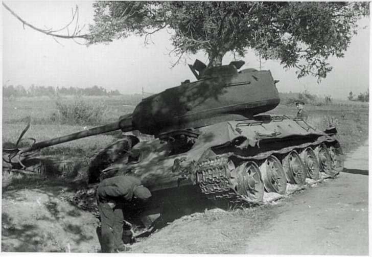 Destroyed Soviet T-34-85 medium tank with a torn barrel gun