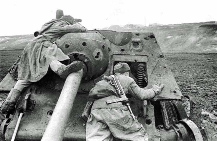 Soviet scouts are watching the enemy under cover destroyed by SU-85 assault gun