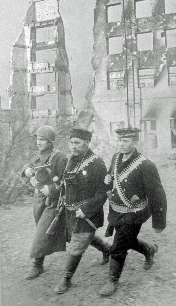 A military patrol in the streets of the destroyed Stalingrad