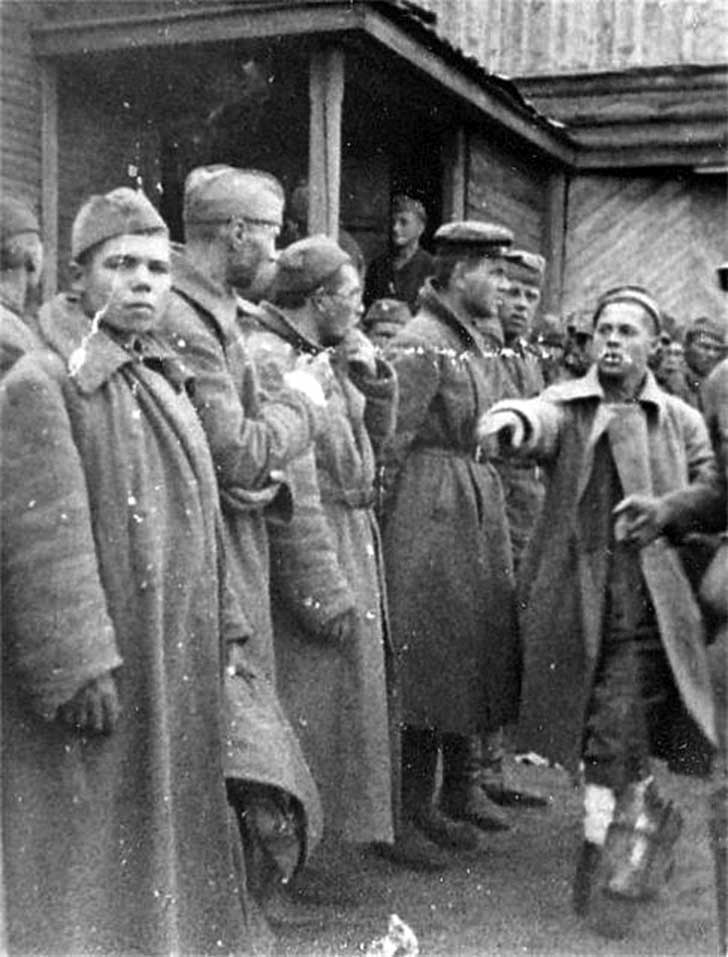 Captured soldier of the Red Army, indicating to the commissars and Communists