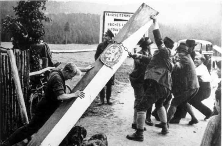 Sudeten Germans break out the Czechoslovak border post