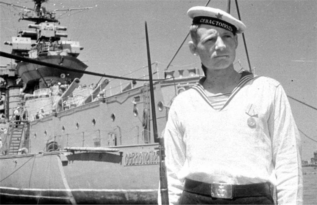 """Watchman on the pier near the battleship """"Sevastopol"""""""