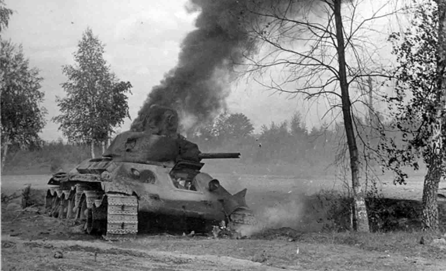 The damaged and burning Soviet T-34 tank