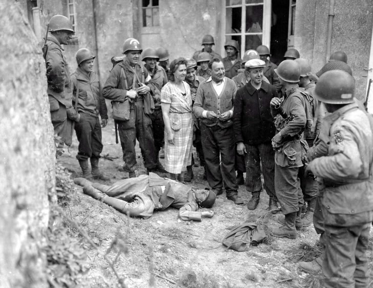 French civilians, American soldiers, German soldier