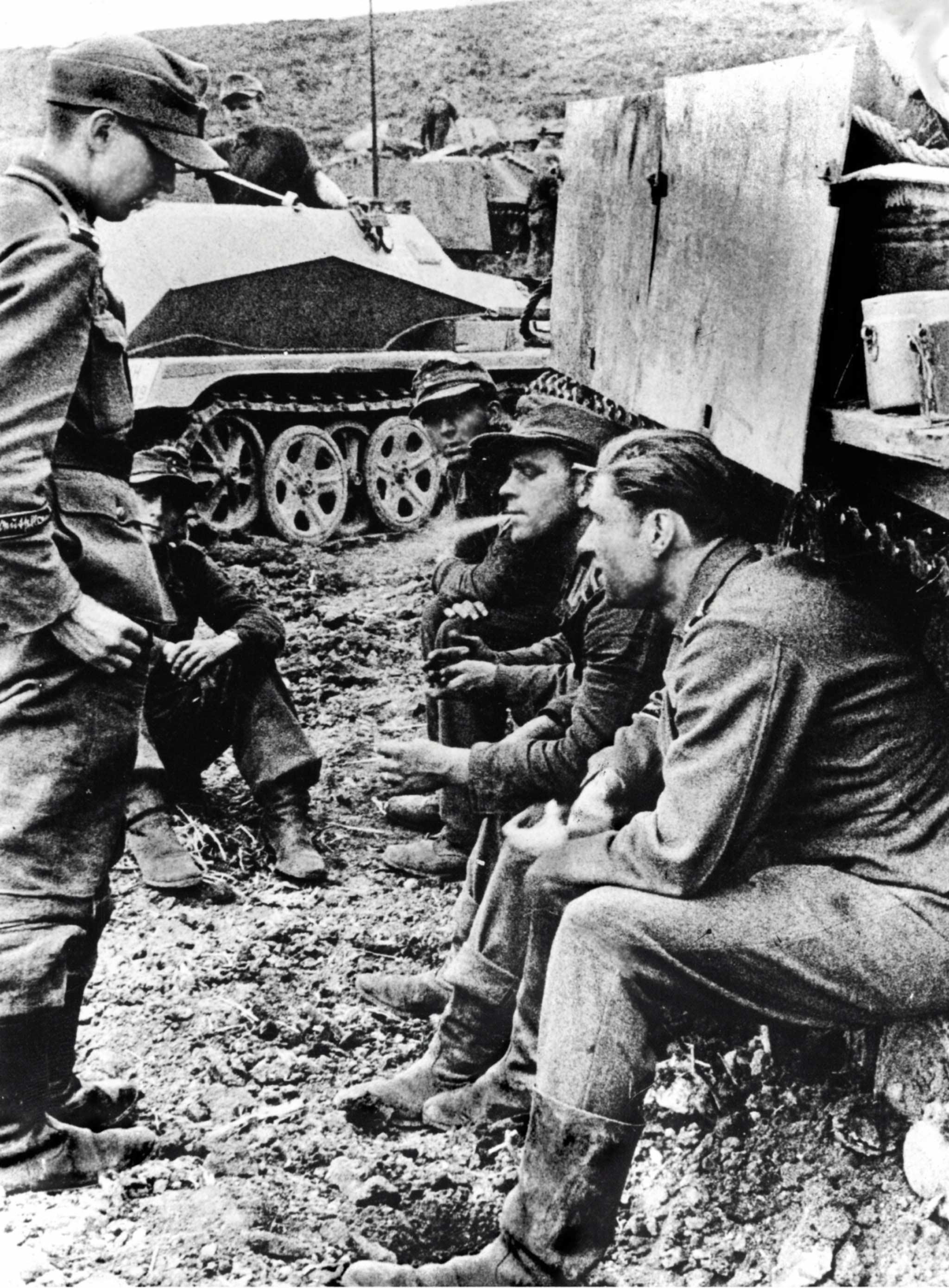German artillerymen of the Großdeutschland division smoke around the