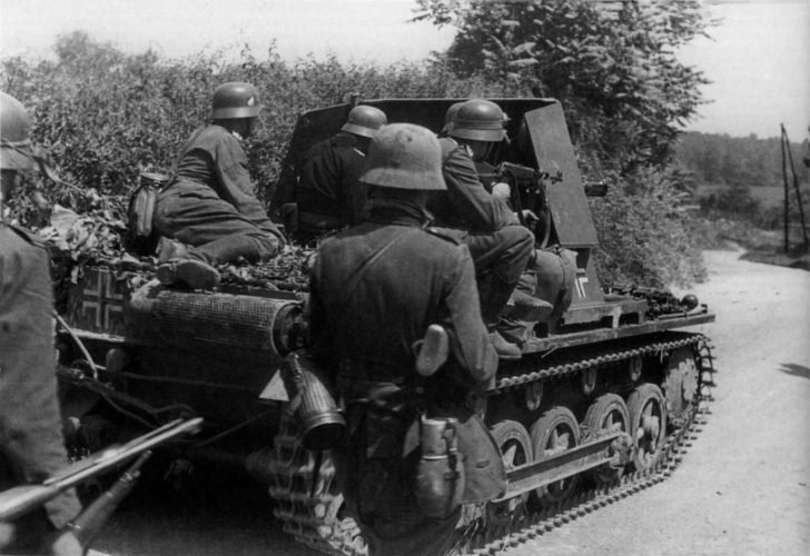 Wehrmacht infantry under the cover of Panzerjager I in Belgium