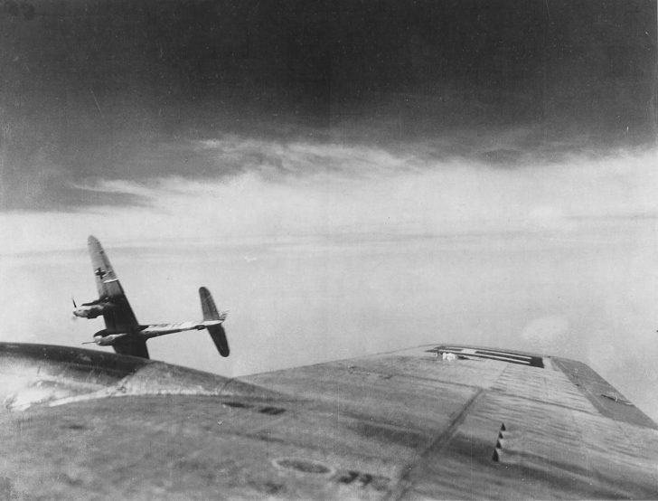 German Messerschmitt Me-410 fighter attacks American bomber B-17 in the sky of Czechoslovakia