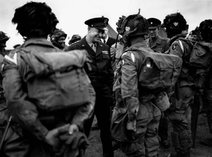 General Eisenhower talks with paratroopers of the 101st Airborne Division on the eve of D-Day