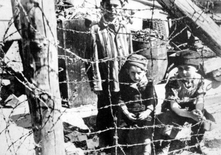 Children behind barbed wire