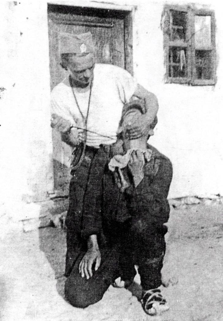 Chetnik kills a Serbian peasant